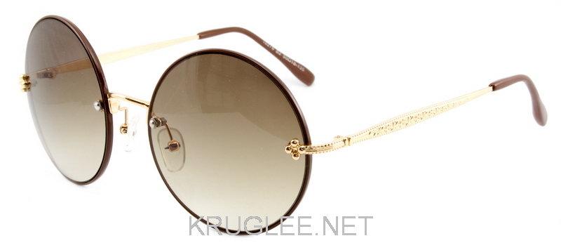 8bca8c56f488 Очки солнцезащитные круглые коричневые в золотисто-коричневой оправе Sepori